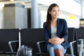 Passenger Asian woman in airport - air travel — Stock Photo
