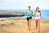 Sports couple jogging for fitness running outside — Stock Photo