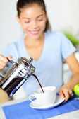 Coffee - woman drinking french press coffee — Stock Photo