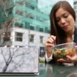 Tablet computer pc and business woman eating salad — Stock Video