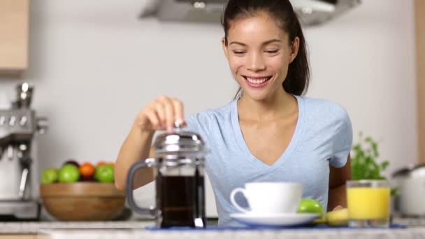 nude woman making coffee