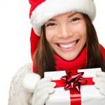Christmas santa woman holding gift — Stock Photo #44255355