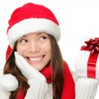 Santa girl holding christmas gift — Stock Photo #44255375