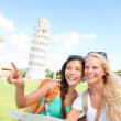 Travel tourists friends holding map in Pisa, Italy — Stock Photo