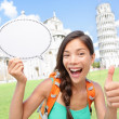 Travel tourist girl showing sign in Pisa, Italy — Stock Photo