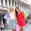 Shopping women walking happy with bags — Stok fotoğraf #44255529