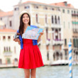 Woman travel tourist with camera in Venice — Stock Photo