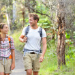Hikers - hiking people walking happy in forest — Stock Photo #44255797