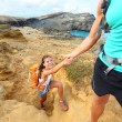 Help - hiker woman getting helping hand hiking — Stock Photo