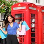 England London shopping woman shopper with bags — Stock Photo