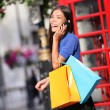 London woman talking happy smart phone shopping — Stock Photo #44255935
