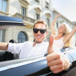 Car driver happy giving thumbs up - driving couple — Stok fotoğraf