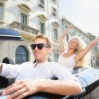 Car people - man driving with happy woman — Stock Photo