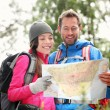 Hiking couple looking at map hiking in forest — Stock Photo #44256163