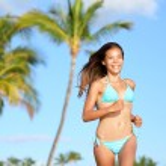 Bikini woman running on beach smiling happy — Stock Photo #44256245