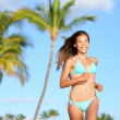 Bikini woman running on beach smiling happy — Stock Photo