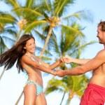 Beach couple fun on vacation dancing playful — Stock Photo #44256263