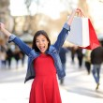 Shopping woman happy on La Rambla street Barcelona — Stock Photo #44256575