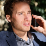 Professional man talking on smartphone — Stock Photo #44256601