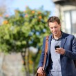 Young urban professional man using smart phone — Stok fotoğraf #44256611