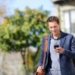Young urban professional man using smart phone — Stock Photo