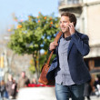 Young urban businessman on smart phone, Barcelona — Stock Photo #44256629