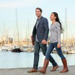 Young couple walking outdoors Port Vell, Barcelona — Stock Photo