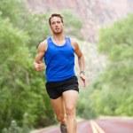 Runner - running athlete man — Stock Photo