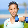 Fitness woman lifting dumbbell weight training — Stock Photo
