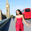 London woman happy walking by Big Ben, England — Stock Photo