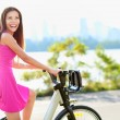 Woman on bike biking in city park — Stock Photo