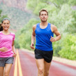 Runners couple in jogging exercise outside — Stock Photo