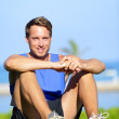 Fitness sports athlete man relaxing after training — Stock Photo #44257527