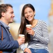 Happy couple drinking coffee talking — Stock Photo