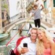 Travel couple in Venice on Gondole ride romance — Stock Photo