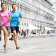 Running runner couple jogging in Venice — Stock Photo