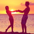 Lovers couple having fun romance on sunset beach — Photo