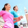 Running jogging couple in Venice — Stock Photo