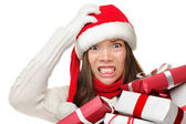Christmas stress - busy santa woman — Stock Photo