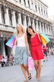 Shopping women walking happy with bags — Stock Photo