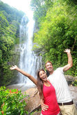 Hawaii tourist people happy by waterfall — Photo
