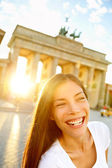 Happy laughing woman at Brandenburg Gate — Stock Photo