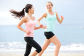 Exercise running women jogging happy on beach — Stock Photo