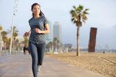 Running woman jogging Barcelona Beach Barceloneta — Stock Photo