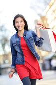 Shopper - woman shopping outside — Stock Photo