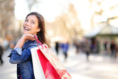 Shopping woman happy and looking away — Stock Photo