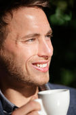 Man closeup portrait at cafe drinking coffee — Stock Photo