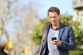Businessman professional on smartphone — Stock Photo
