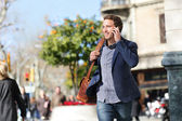 Young urban businessman on smart phone, Barcelona — Stock Photo