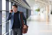 Urban business man talking on smart phone — Stock Photo